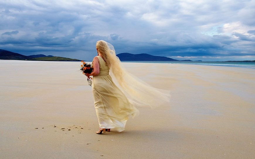 A bride on a beach.